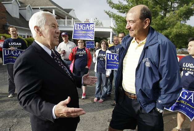 Sen. Richard Lugar talks with Joe Purichia before voting on Tuesday, May 8, 2012, in Greenwood, Ind. Lugar is being challenged by two-term state Treasurer Richard Mourdock. (AP Photo/Darron Cummings) Photo: Darron Cummings, Associated Press