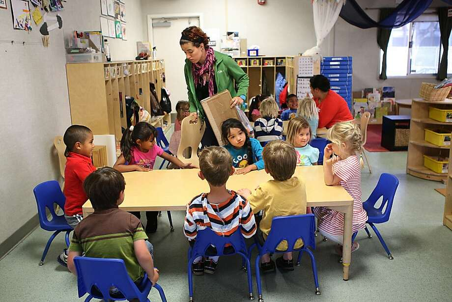 Deborah Massana (in green jacket) teaches her class at Daniel Webster Elementary's preschool. The preschool's board has been chosen by the city to open a second campus in September. Photo: Liz Hafalia, The Chronicle