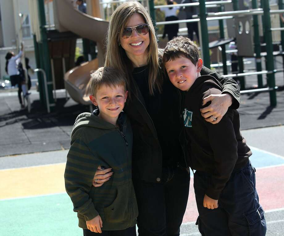 """Revisiting """"Potrero Kids"""" a preschool at Daniel Webster Elementary school that was started by neighboring parents in San Francisco, Calif.,  as Dena Fischer met with her twins Henry Rothenberg (left) and Sam Rothenberg (right), both 8 years old and now in second grade during recess on Tuesday, May 1, 2012.  Dena was one of the seven parents that helped establish the preschool. Photo: Liz Hafalia, The Chronicle"""