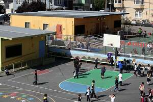"""Revisiting """"Potrero Kids"""" (two yellow bungalows) a preschool at Daniel Webster Elementary school on Tuesday, May 1, 2012, that was started by neighboring parents in San Francisco, Calif."""