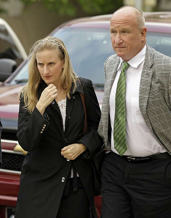 Eileen Mancera, left, a financial adviser to the John Edwards campaign, arrives at the Federal courthouse in Greensboro, N.C., Tuesday, May 8, 2012 for the trial of former presidential candidate and Sen. John Edwards. Edwards is accused of conspiring to secretly obtain more than $900,000 from two wealthy supporters to hide his extramarital affair with Rielle Hunter and her pregnancy. He has pleaded not guilty to six charges related to violations of campaign-finance laws. Man on right is unidentified. (AP Photo/Chuck Burton) Photo: Chuck Burton, Associated Press