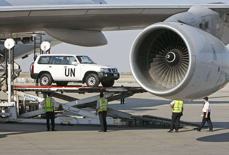 A vehicle for the UN observers is offloaded from a plane at the Damascus airport in Syria, Tuesday, May, 8, 2012. Special envoy Kofi Annan is to brief the U.N. Security Council on Tuesday about the situation in the country, where about 40 U.N. observers are trying to calm the situation. U.N. officials hope to deploy a larger force of up to 300 observers. (AP Photo/Muzaffar Salman) Photo: Muzaffar Salman, Associated Press