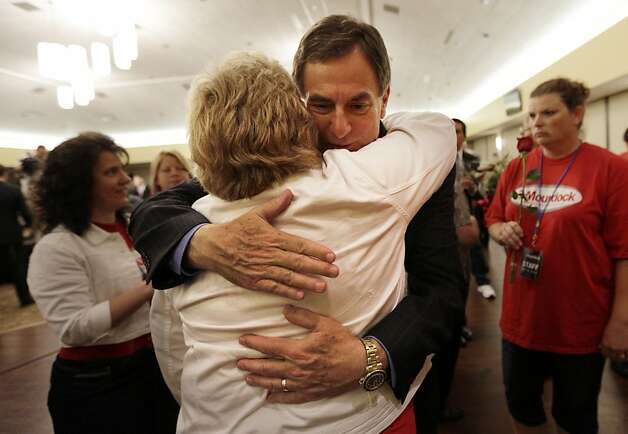 Indiana Treasurer Richard Mourdock hugs a supporter in Indianapolis, Tuesday, May 8, 2012, after he defeated incumbent Sen. Richard Lugar, R-Ind., in the primary. (AP Photo/AJ Mast) Photo: AJ Mast, Associated Press