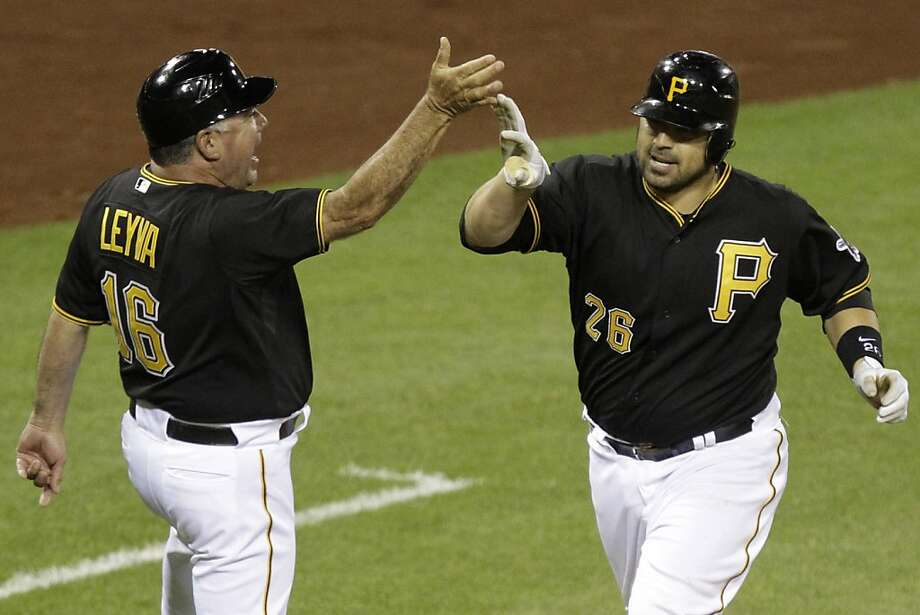 Pittsburgh Pirates' Rod Barajas (26) rounds third to greetings from coach Nick Leyva (16) after hitting a two-run walk-off homer off Washington Nationals  pitcher Henry Rodriguez in the ninth inning of a baseball game in Pittsburgh Tuesday, May 8, 2012. The Pirates won 5-4. (AP Photo/Gene J. Puskar) Photo: Gene J. Puskar, Associated Press