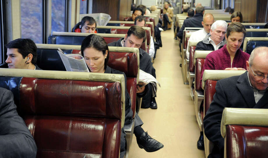 Commuters ride the Metro-North train from Stamford, Conn. to Grand Central Terminal in New York on Thursday, February 16, 2012. Photo: Lindsay Niegelberg / Stamford Advocate