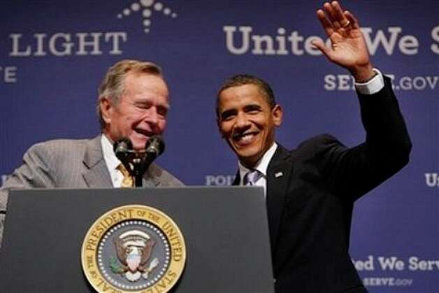 With George Bush at Texas A&M. (Associated Press)