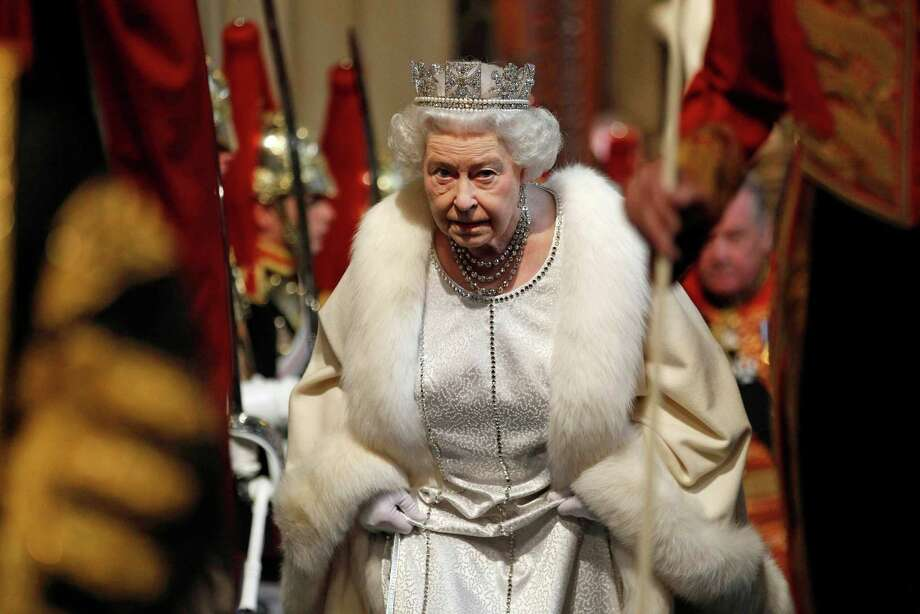 TOPSHOTS  Britain's Queen Elizabeth II arrives at the Norman Porch in the Palace of Westminster, home to the Houses of Parliament, in London on May 9, 2012 during the State Opening of Parliament. AFP PHOTO / POOL / SUZANNE PLUNKETTSUZANNE PLUNKETT/AFP/GettyImages Photo: SUZANNE PLUNKETT, AFP/Getty Images / AFP