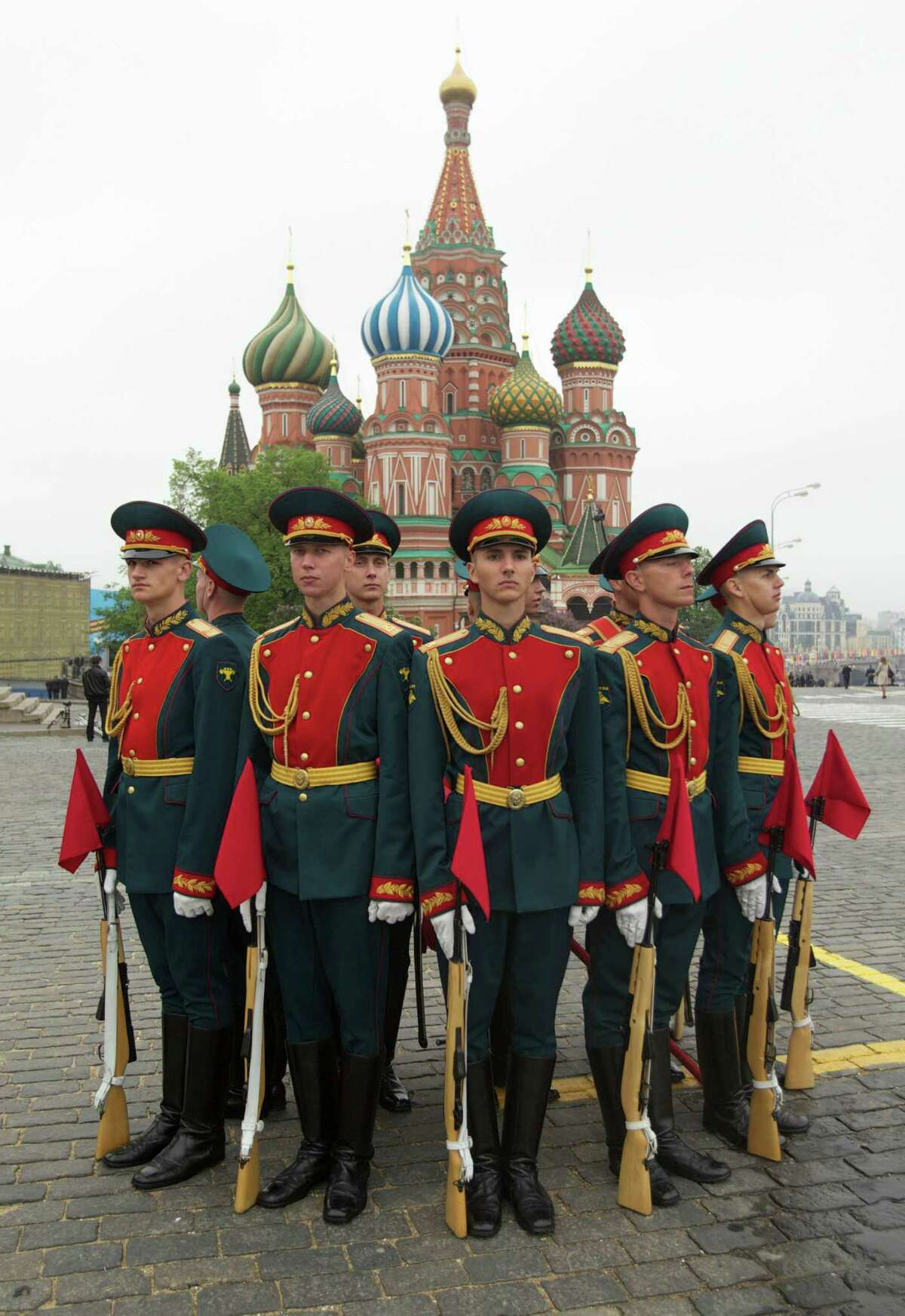Russian honor guard soldiers stand after the Victory Day Parade, which commemorates the 1945 defeat of Nazi Germany, on the Red Square in Moscow, Russia, Wednesday, May 9, 2012, with St. Basil Cathedral at the background.