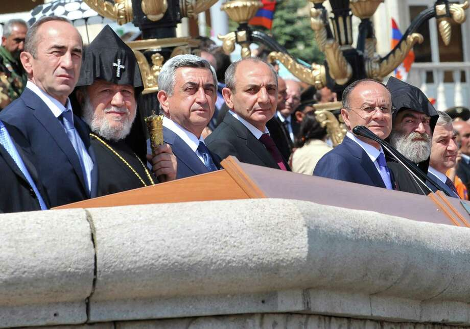 Armenia's President Serzh Sarkisian (3rd L) , the Armenian Apostolic Church leader, Catholicos Garegin II (2nd L) and President of Azerbaijan's breakaway region of Nagorny Karabakh, Bako Sahakyan ( 4th L) stand at a podium  in Stepanakert, the capital of Nagorny Karabakh, on May 9, 2012, as they watch a military parade marking Victory Day, the 67th anniversary of the Soviet victory over Nazi Germany, an the 20th anniversary of what Armenians called the liberation of the Nagorny Karabakh. Yerevan and Baku are locked in a bitter dispute over the region of Nagorny Karabakh, which Armenian separatists backed by Yerevan seized from Azerbaijan in a war in the 1990s that left some 30,000 people dead.AFP PHOTO /  KAREN MINASYANKAREN MINASYAN/AFP/GettyImages Photo: KAREN MINASYAN, AFP/Getty Images / AFP