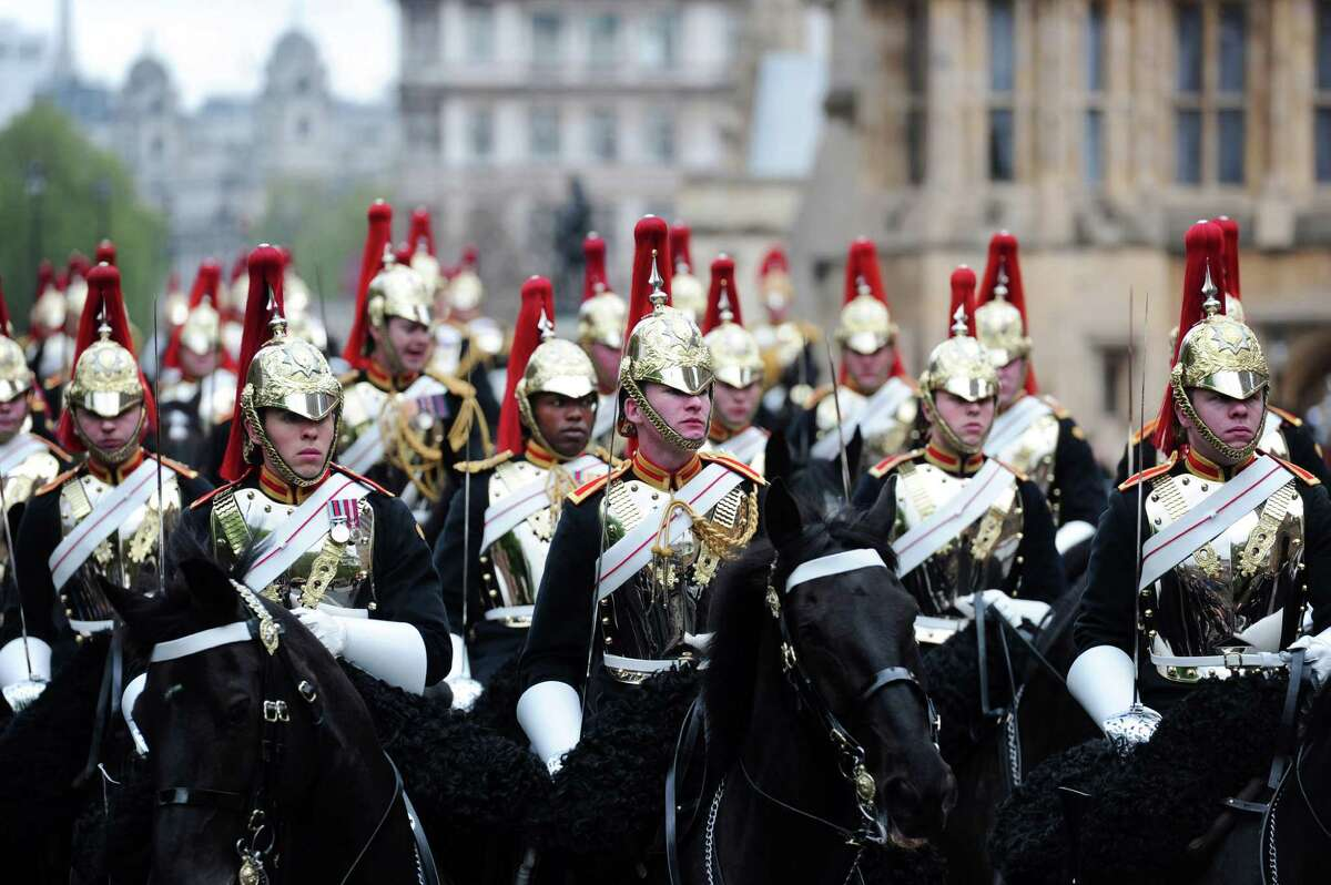 LONDON, ENGLAND - MAY 09: Soldiers from the Household Cavalry wait outside the Palace of Westminster during the State Opening of Parliament on May 9, 2012 in London, England. Queen Elizabeth II unveiled the coalition government's legislative programme in a speech delivered to Members of Parliament and Peers in The House of Lords. New legislation is expected to be introduced on banking reform, House of Lords reform, changes to public sector pensions and plans for increased internet monitoring.