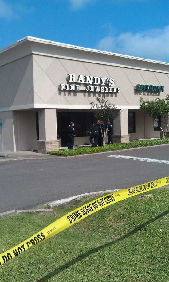 Randy's Fine Jewelers, on Dowlen Road, was the scene of a robbery for the second time in less than a month. Guiseppe Barranco/The Enterprise. Photos tweeted at @SpotNewsShooter.