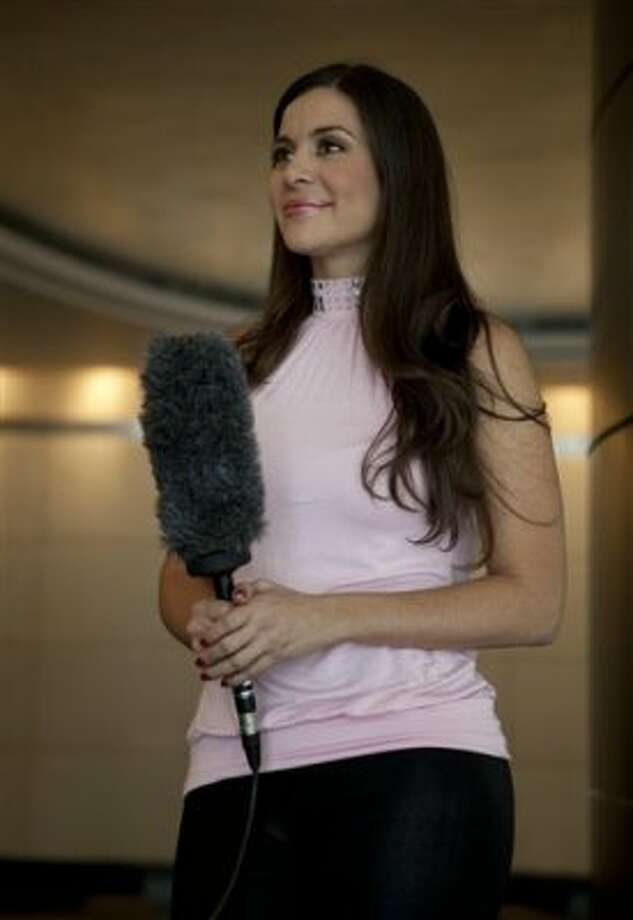 Model Julia Orayen, from Argentina, holds a microphone during an interview in Mexico City, Tuesday, May 8, 2012. Orayen has posed nude for Playboy and appeared barely dressed in other media, but she made her mark on Mexican minds Sunday night by carrying an urn filled with bits of paper determining the order that candidates would speak during a presidential debate.  (AP Photo/Eduardo Verdugo) (AP)