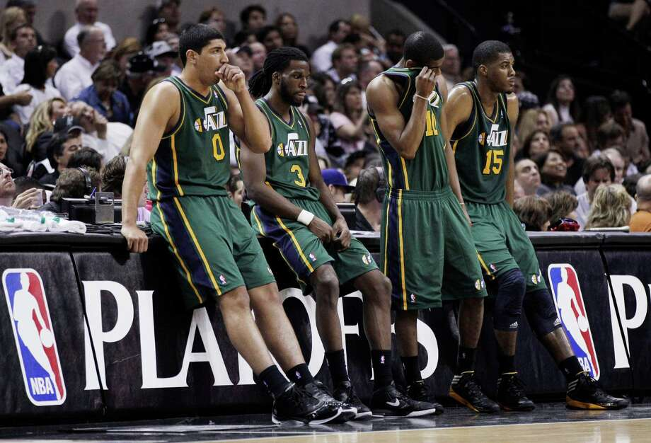 Utah Jazz's Enes Kanter (0), DeMarre Carroll (3), Alec Burks (10) and Derrick Favors (15) wait on the sideline during a timeout in the fourth quarter of Game 2 of a first-round NBA basketball playoff series against the San Antonio Spurs, Wednesday, May 2, 2012, in San Antonio. San Antonio won 114-83. Photo: AP