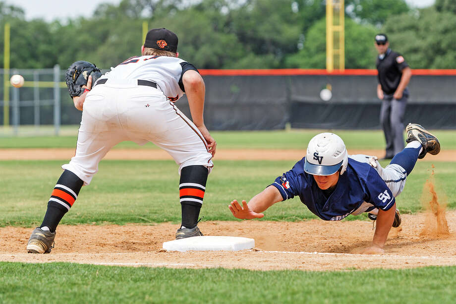Smithson Valley's Joey Bochat dives back to first base to beat the pick off throw to Medina Valley's David Wurzbach during the second game of their bidistrict playoff series with Medina Valley at the Medina Valley baseball field on May 5, 2012. Smithson Valley won the opening game at home 6-1, led 6-2 going into the bottom of the sixth inning in game two before losing 8-6 and then came back to beat the Panthers 12-2 in five innings to win the series.  Photo by Marvin Pfeiffer / Prime Time Newspapers Photo: MARVIN PFEIFFER, Marvin Pfeiffer / Prime Time Newspapers / Prime Time Newspapers 2012