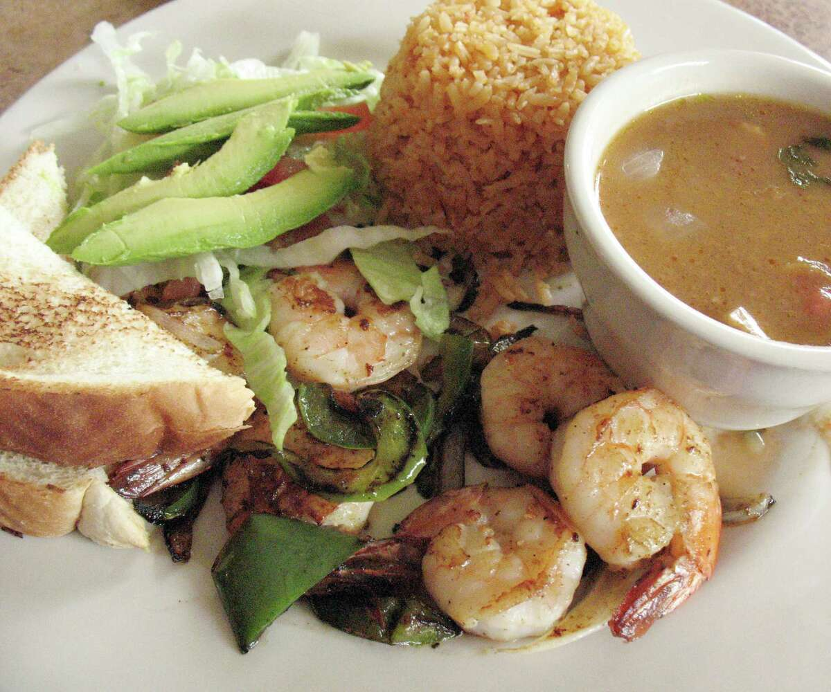 For SA Life Just a Taste: Grilled shrimp with charro beans, rice and Texas toast at the new location of Pete's Take House.