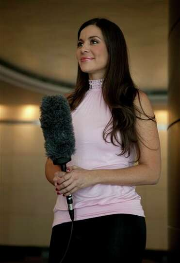 Model Julia Orayen, from Argentina, holds a microphone during an interview in Mexico City, Tuesday,