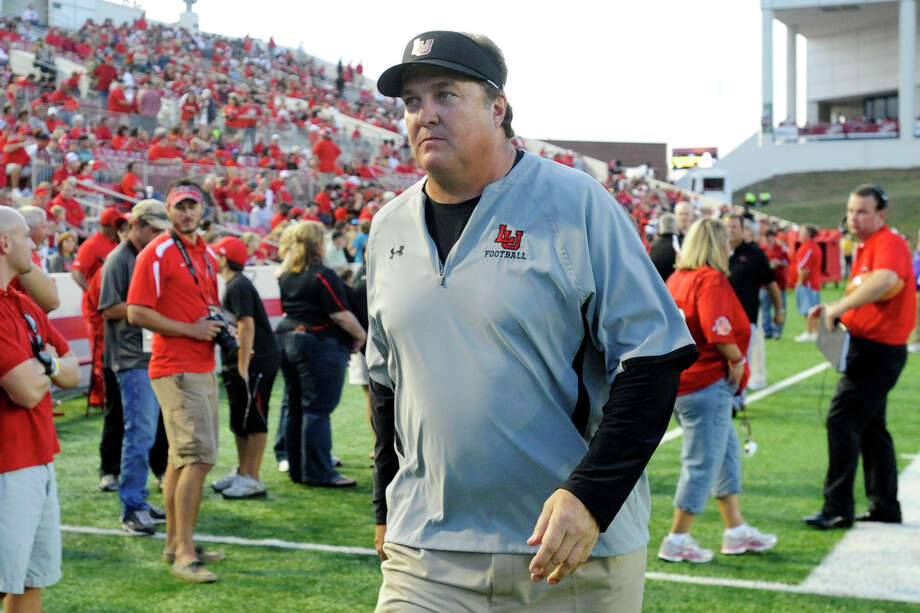 Lamar Cardinals head football coach Ray Woodard prepares to take the field with his team against Northwestern State at Provost Umphrey Stadium. Saturday, October 8, 2011.  Valentino Mauricio/The Enterprise Photo: Valentino Mauricio