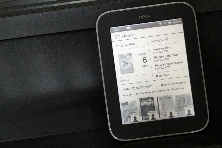 Tablets, such as this Nook Simple Touch with Glowlight, can be engraved and loaded with Mom's favorite books. Photo: Mary Altaffer, Associated Press / AP