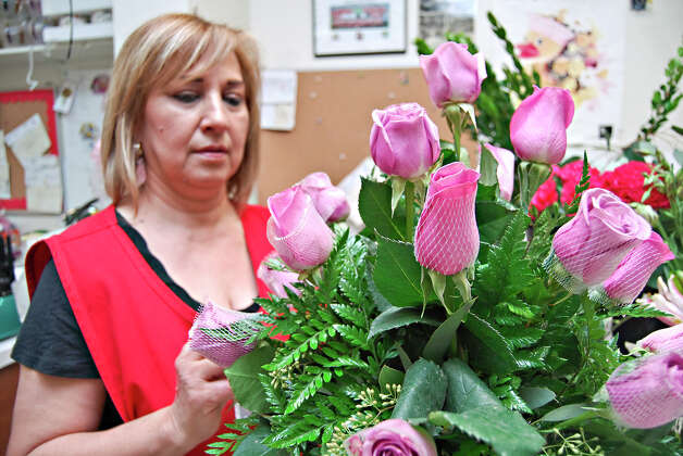 Florist Laura Garza designs a Telefora's Dazzle her bouquet as preperation for Mother's Day at Garza Flower Shop. Photo: Ulysses S. Romero, Staff Photographer