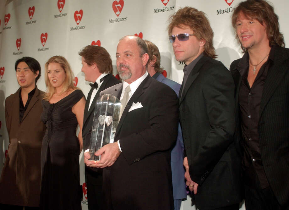 Grammy-winning musician Billy Joel, center, stands with fellow musicians Richard Joo, from left, Diana Krall, Don Henley, Jon Bon Jovi and Richie Sambora after Joel received Person of the Year award before the 12th Annual Musicares tribute dinner Monday, Feb. 25, 2002, in Los Angeles. Photo: JOHN HAYES, AP / AP