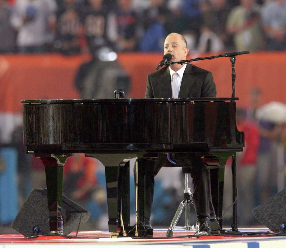 Billy Joel, shown singing the national anthem before Super Bowl XLI in Miami, turned 63 on Wednesday, May 9. Photo: Gary W. Green, MCT / MCT