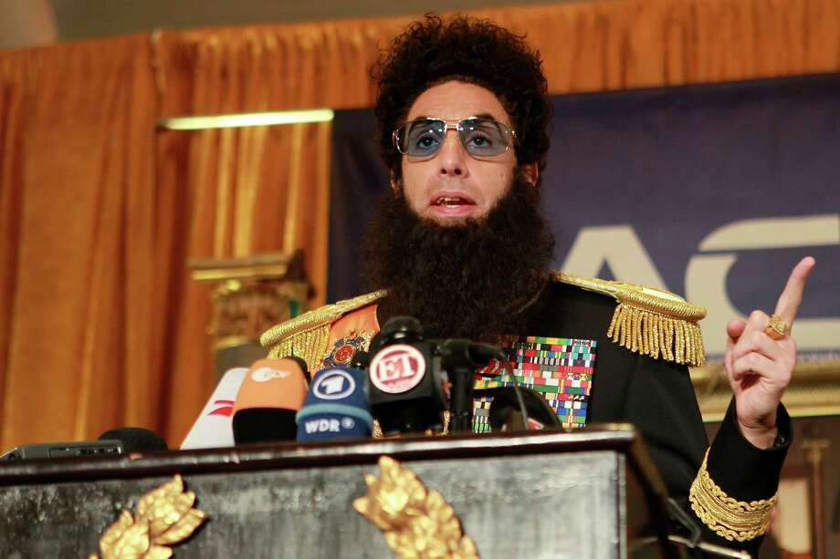 """Sasha Baron Cohen, dressed as his alter-ego Admiral General Aladeen from his upcoming film, """"The Dictator,"""" speaks during a news conference, Monday, May 7, 2012, at The Waldorf Astoria Hotel in New York. The film, about a dictator from a fictional North African country, stars Cohen, Ben Kingsley and Anna Faris and is set for release on May 16. (AP Photo/Starpix, Dave Allocca) Photo: Dave Allocca"""