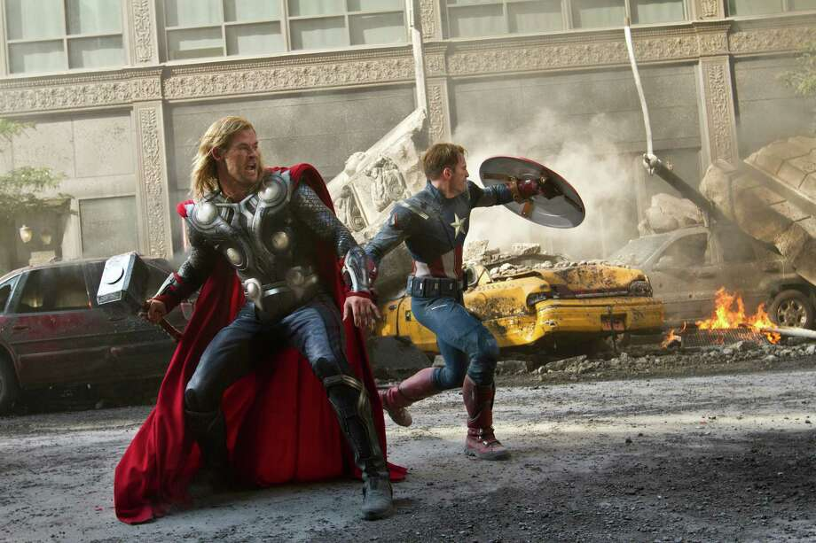 """In this film image released by Disney, Chris Hemsworth portrays Thor, left, and  and Chris Evans portrays Captain America in a scene from """"The Avengers,"""" expected to be released on May 4, 2012. (AP Photo/Disney, Zade Rosenthal) Photo: Zade Rosenthal / © 2011 MVLFFLLC.  TM & © 2011 Marvel.  All Rights Reserved."""