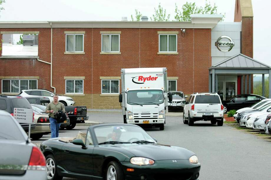 A rental truck containing documents drives away on Wednesday, May 9, 2012, at Saratoga Nissan in Malta, N.Y. Investigators raided the dealership. (Cindy Schultz / Times Union) Photo: Cindy Schultz