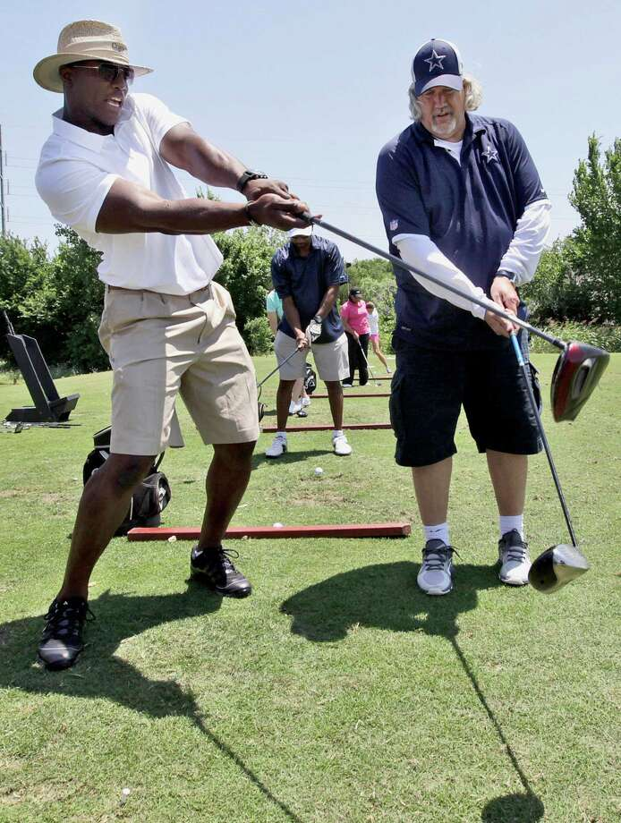 Cowboys linebacker DeMarcus Ware (left) gives swing tips to defensive coordinator Rob Ryan at the Dallas Cowboys annual golf tournament in Grapevine. Photo: AP