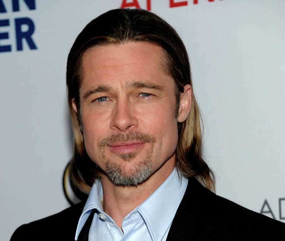 """FILE - In this March 3, 2012 file photo, actor Brad Pitt arrives at the Los Angeles premiere of the play """"8"""" in Los Angeles. Chanel announced Wednesday, May 9, that Pitt will star in an upcoming ad campaign for its signature women's scent. Previously the French-based house had used other famous names as its models, including Catherine Deneuve, Nicole Kidman and Audrey Tautou. (AP Photo/Dan Steinberg, file) Photo: DAN STEINBERG"""
