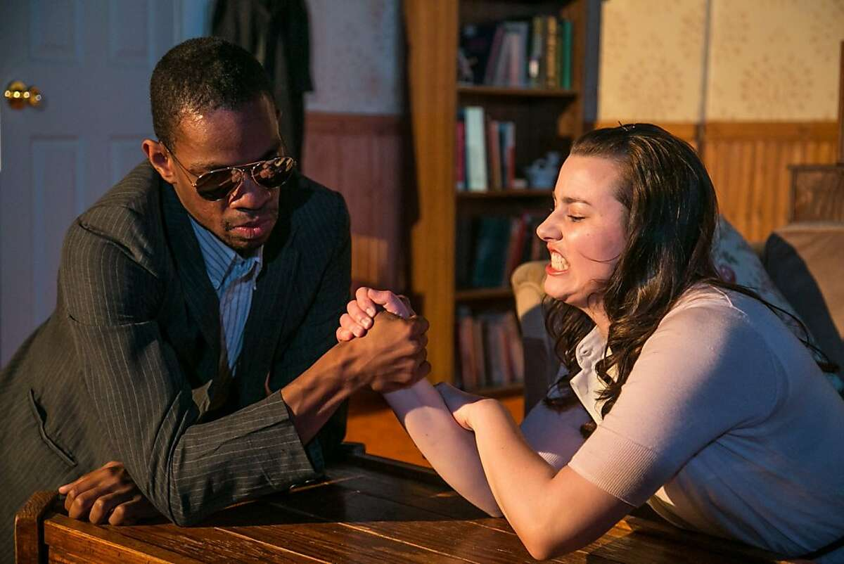 """Liz (Marissa Keltie, right) encounters a very altered version of her best friend Chris (Reggie D. White) in the world premiere of Lauren Yee's """"Crevice"""" at Impact Theatre"""