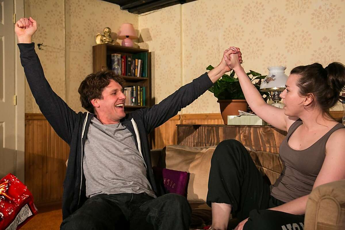 """Grown siblings Rob (Timothy Redmond, left) and Liz (Marissa Keltie) still live aimlessly at home in the world premeire of Lauren Yee's """"Crevice"""" at Impact Theatre"""