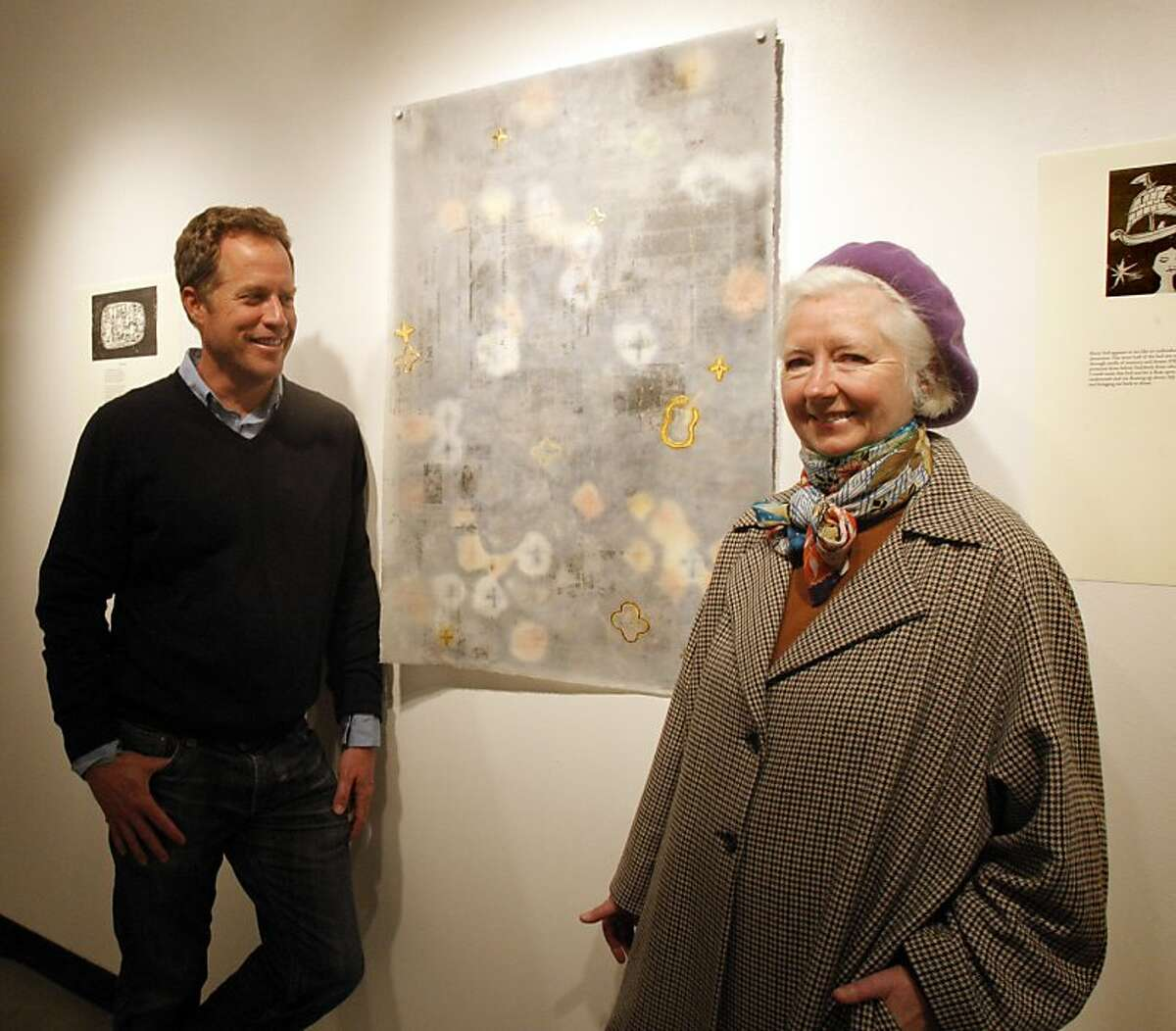 Artist Patricia Kelly, right, and writer Vince Montague pose for a picture next to