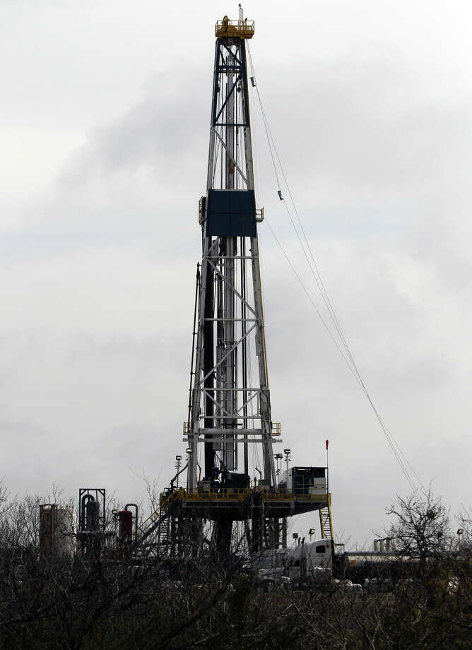 Drilling rigs, such as this one near Tilden in McMullen County, have sprouted throughout counties in the Eagle Ford Shale. Photo: San Antonio Express-News File Photo