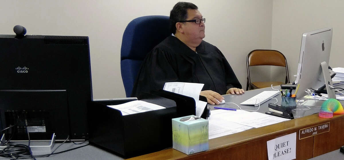 Municipal Court Judge Alfredo Tavera will be able to speak to residents about their parking and traffic tickets through a video kiosk system. Tuesday, May 8, 2012.