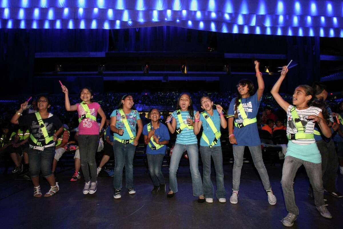 Students from Five Palms Elementary School dance during the 72nd Annual School Safety Patrol Rally on Wednesday, May 9, 2012, at the Alamodome. The event, which is sponsored by the San Antonio Police Department and the Kiwanis Club of San Antonio, recognizes school safety patrols for their volunteer work.