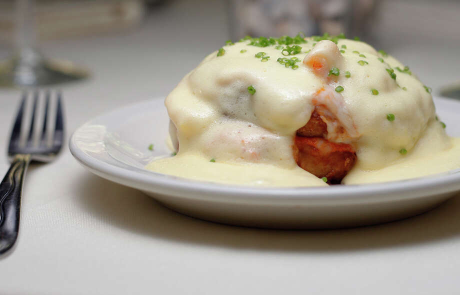Eggplant Josephine is one of Bella on the River Restaurant's signature dishes. The appetizer features sliced, fried eggplant smothered in sauce diablo, mozzarella, sauteed shrimp and hollandaise sauce. Photo: KIN MAN HUI, SAN ANTONIO EXPRESS-NEWS / SAN ANTONIO EXPRESS-NEWS