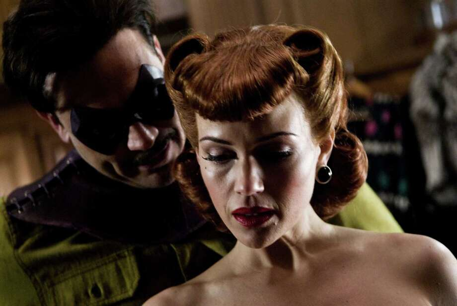 "Carla Gugino (with Jeffrey Dean Morgan) played the first Silk Spectre in the 2009 comic book-turned-movie ""Watchmen."" Photo: Clay Enos And TM & © DC Comics, Warner Brothers / © 2008 Warner Bros Entertainment Inc."