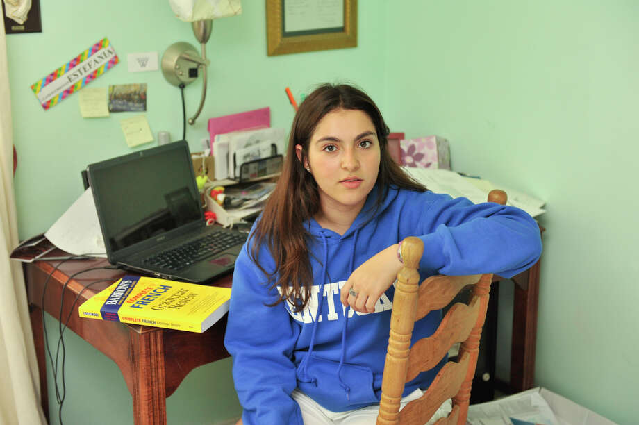 Estafania Lamas, 18, has spent the money from her previous summer jobs on things like AP and SAT test fee's and study guides as well as costs associated with competing on the debate team. She plans to use this summer's money to offset college costs. Photo: Robin Jerstad, SPECIAL TO THE EXPRESS-NEWS