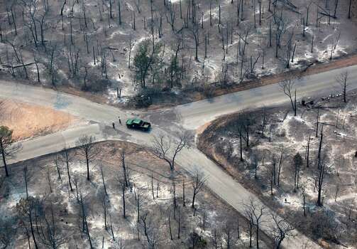 A Texas Parks and Wildlife vehicle is seen at an intersection in this Tuesday Sept. 6, 2011 aerial image taken over the wildfires in the Bastrop, Texas area.    (William Luther/wluther@express-news.net) Photo: WILLIAM LUTHER, SAN ANTONIO EXPRESS-NEWS / 2011 SAN ANTONIO EXPRESS-NEWS