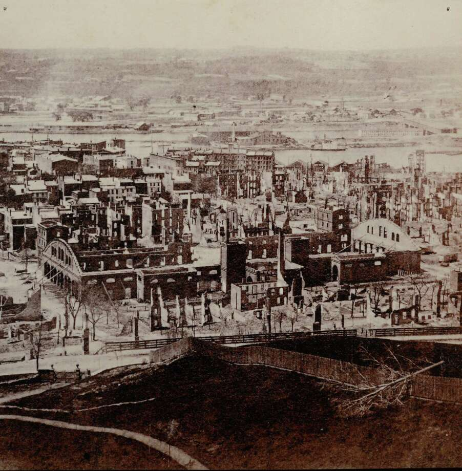 A view of downtown Troy, N.Y. before the Great Fire made from a historical image at the Rensselaer County Historical Society offices May 9, 2012.  (Skip Dickstein / Times Union) Photo: SKIP DICKSTEIN / 2012
