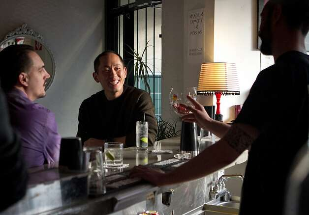 Bartender Luca Martini talks with customers in the bar at Specchio Restaurant in San Francisco , Calif., on Thursday, May 3rd, 2012. Photo: John Storey
