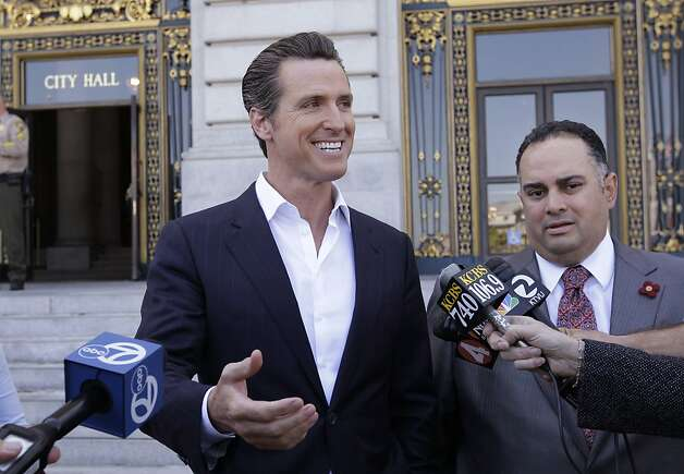 California Lt. Gov. Gavin Newsom, left, smiles next to Calif. Assembly Speaker John Perez, D-Los Angeles, right, during a news conference in front of San Francisco City Hall Tuesday, May 9, 2012 as he reacts to his support of President Barack Obama declaring his support for gay marriage. Newsom was the mayor of San Francisco when the first gay marriages were allowed in California. (AP Photo/Paul Sakuma) Photo: Paul Sakuma, Associated Press