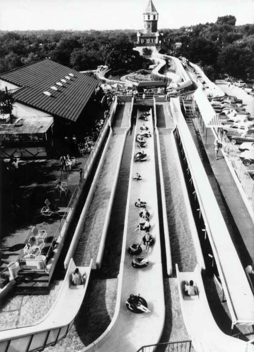 Schlitterbahn celebrates its 35th anniversary this year. Click through to see Schlitterbahn in its early years.In 1989, visitors ride a water slide below Schlitterbahn's trademark German castle during the park's 10th anniversary season. When Schlitterbahn Water Park opened in 1979, it consisted of the German Castle (in background) and four water slides.