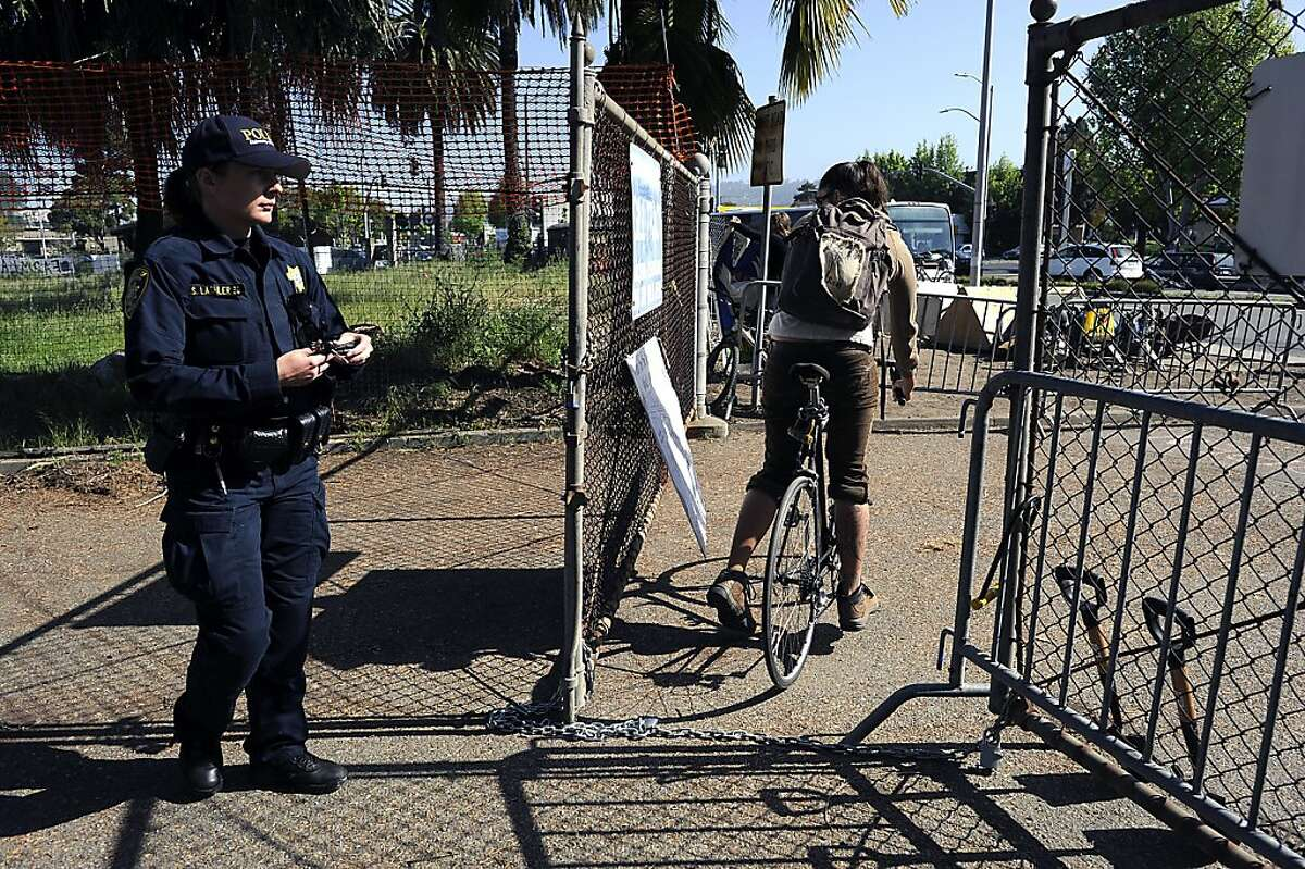 Police officers blocked the gate on San Pablo Ave. to vehicles but pedestrians were free to pass through. Occupiers with Occupy the Farm braced for a possible police raid at the Gill Tract in Albany, CA Wednesday May 9th, 2012.