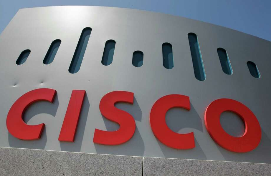 Exterior view of Cisco headquarters in Santa Clara, Calif., Wednesday, May 9, 2012. Cisco Systems Inc.'s quarterly earnings surged 20 percent in the latest sign that a recently completed overhaul is paying off for the world's largest maker of computer-networking equipment. (AP Photo/Paul Sakuma) Photo: Paul Sakuma