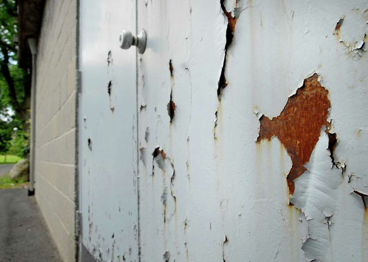 Paint peels off an exterior door at the Eastern Greenwich Civic Center in Old Greenwich.