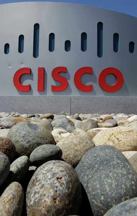 Exterior view of Cisco headquarters in Santa Clara, Calif., Wednesday, May 9, 2012. Cisco Systems Inc.'s quarterly earnings surged 20 percent in the latest sign that a recently completed overhaul is paying off for the world's largest maker of computer-networking equipment. (AP Photo/Paul Sakuma) Photo: Paul Sakuma / Associated Press / AP