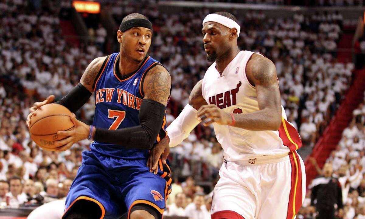 LeBron James the Heat, right, defends Carmelo Anthony of the Knicks during Wednesday's playoff game.