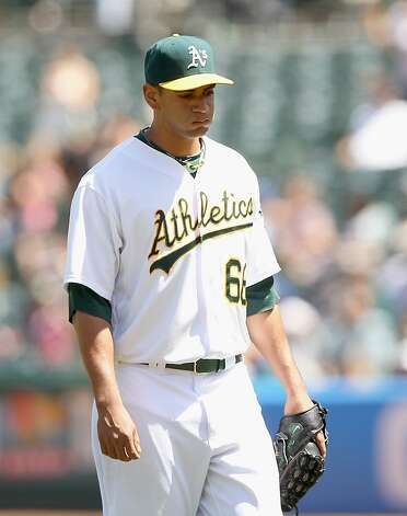 OAKLAND, CA - MAY 09:  Tyson Ross #66 of the Oakland Athletics leaves the game after giving up a run with the sixth inning against the Toronto Blue Jays at O.co Coliseum on May 9, 2012 in Oakland, California.  (Photo by Ezra Shaw/Getty Images) Photo: Ezra Shaw, Getty Images
